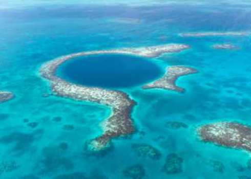Iucn Iii Aerial View Of The Blue Hole In The Caribbean Off The Coast Of Belize 168067598 Tami Freed